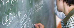 Student Writing on Blackboard